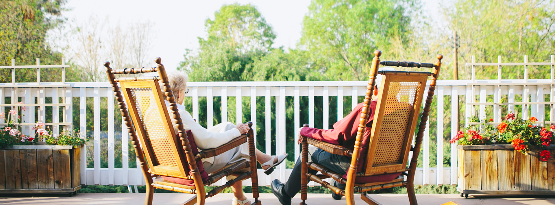 two seniors relaxing in the balcony