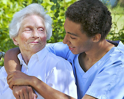 a happy home health aide and a senior woman