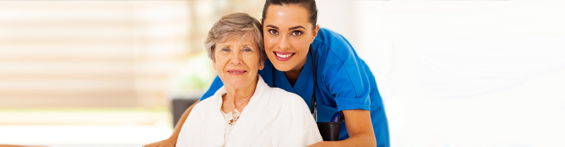 a nurse and a senior woman smiling
