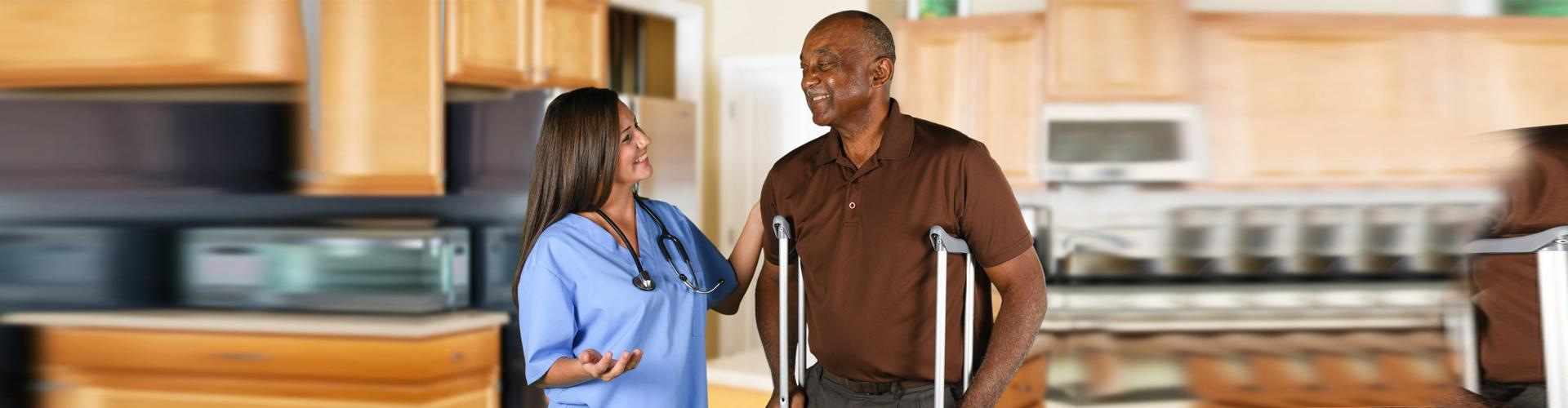 a nurse and a senior man talking
